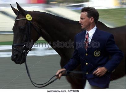 """American rider David O'Connnor runs his horse """"Giltedge"""" at a trot towards a team of veterinarians, September 15, 2000 during the Three-Day Event team vet inspection at the Sydney Equestrian Center Stadium. The Three-Day Eventing begins tomorrow and O'Connor is a medal contender. JWH/HB"""