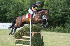 Oliver Townend (GBR) riding Ridire Dorcha Taking Part in the Cross Country Phase